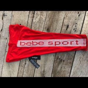 NWT BeBe Orange Capri Leggings w/Logo Down Side LG